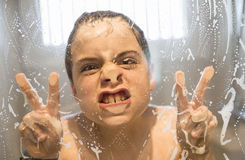 Young boy playing in the shower Stock Image