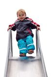 Young boy playing on slide Stock Image