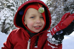 Young boy playing in the snow. Caucasian boy playing in the snow during winter Stock Images
