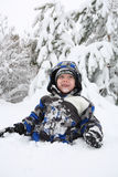 Young boy playing in the snow Royalty Free Stock Image
