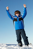 Young Boy Playing In Snow On Holiday In Mountains Stock Image