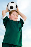 Young boy playing soccer Stock Photography