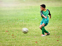 Young boy playing soccer Stock Photo
