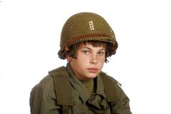 Young boy playing soldier. Young boy dressed-up and playing soldier Stock Image