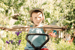 Young boy playing with a stick and gesturing Royalty Free Stock Images