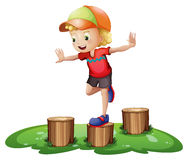 A young boy playing with the stump Royalty Free Stock Photo