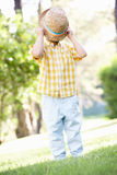 Young Boy Playing In Summer Garden Royalty Free Stock Photography