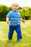 Young Boy Playing In Summer Garden Royalty Free Stock Photos
