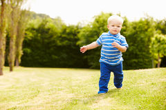 Young Boy Playing In Summer Garden Stock Photos