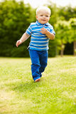 Young Boy Playing In Summer Garden Royalty Free Stock Image