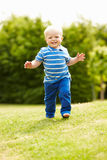 Young Boy Playing In Summer Garden Stock Image