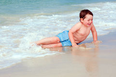 Young boy playing in surf Royalty Free Stock Photography
