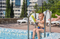 Young boy playing in a swimming pool Stock Photo