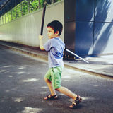 Young boy playing with sword Royalty Free Stock Images
