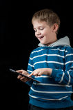 Young boy playing on tablet Stock Photography