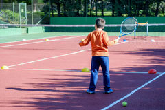 Young boy playing tennis Royalty Free Stock Photos