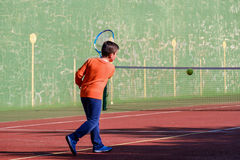 Young boy playing tennis Royalty Free Stock Photo