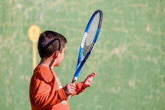Young boy playing tennis. On a court Stock Photos