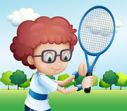 A young boy playing tennis Stock Photos