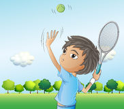 A young boy playing tennis Stock Photography