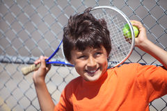 Young boy playing tennis Stock Photos