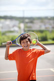 Young boy playing tennis Stock Photo