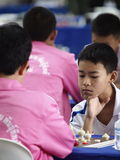 Young boy playing Thai chess Royalty Free Stock Photos