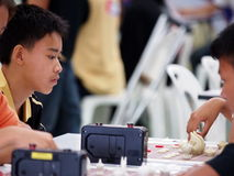 Young boy playing Thai chess Stock Photography