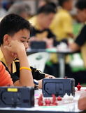 Young boy playing Thai chess Royalty Free Stock Image