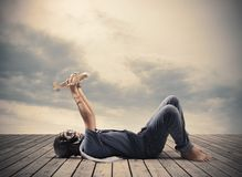 Young boy playing with toy airplane. Young boy playing with toy wooden airplane Stock Images
