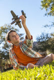 Young Boy Playing WIth Toy Model Airplane Outside Stock Images