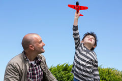 Young boy playing with a toy plane Royalty Free Stock Photo