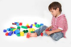 Young boy playing with toys Stock Image
