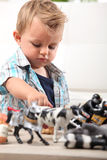 Young boy playing with toys Stock Photos