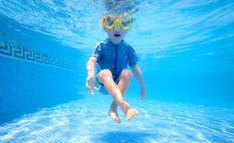 Young boy playing underwater stock image