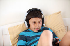 Young boy playing video game with copy space Stock Photo