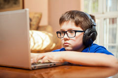 Young boy playing video games Royalty Free Stock Images