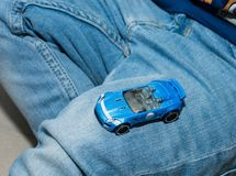 Young boy playing with vintage toy cars at home. Selective focus on hand of boy and toy. Stock Image