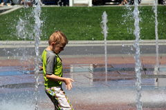 Young boy playing in waterfountain,Boston,Mass,Summertime,2013 Stock Photography