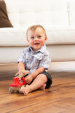 Young Boy Playing With Wooden Toy Car At Home Stock Images