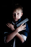 Young boy plays Bond Stock Images