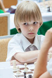 Young boy plays chess Royalty Free Stock Image