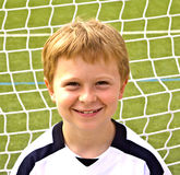 Young boy plays soccer Stock Photo