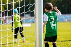 Young boy plays soccer football match on the pitch. Soccer footb. All match for kids. Youth soccer background Stock Images