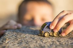 Free Young Boy Plays With Toy Car. Little Boy Playing With Car Toy On Sunset Royalty Free Stock Photo - 159049825