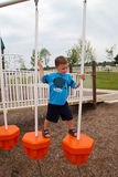 Young Boy on Playscape. A photo of a young boy walking across a playscape balance device Royalty Free Stock Image