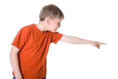Young boy pointing at. Something stock photography