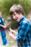 Young boy pointing backwards Royalty Free Stock Image