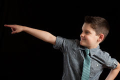Young Boy Pointing In Direction Royalty Free Stock Photo
