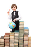 Young boy is pointing on a globe Stock Photography
